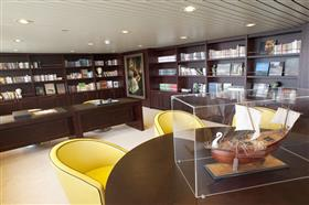 Wood panels and warm colours in the on board  library