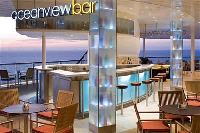 The Ocean View Bar onboard Celebrity Reflection offers stunning views of the waves.