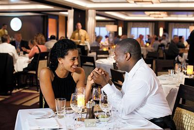 A couple enjoying dinner on the Norwegian Epic