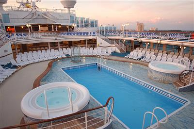 A view from the balcony of the outdoor swimming pool and whirpool baths onboard of Royal's Caribbean Princess.