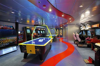 The Video Arcade including table hockey and  Guitar  Hero on deck 12 of the Serenade of the Seas