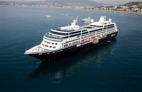 An aerial view of Azamara Quest while leaving the coast.