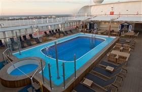 Saga Sapphire's outdoor pool served by the Beach Club bar
