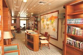 The library on Saga Pearl's Promenade deck