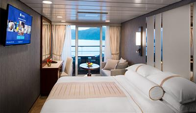 The Club Continent Suite with a spacious balcony on the Azamara Quest.