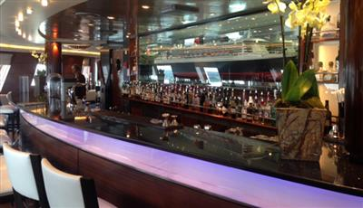 The Commodore Club, a lounge on deck 9 with panoramic views from Queen Mary's bow