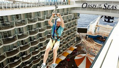 A passenger on a Zipline ride on the Oasis of the Seas