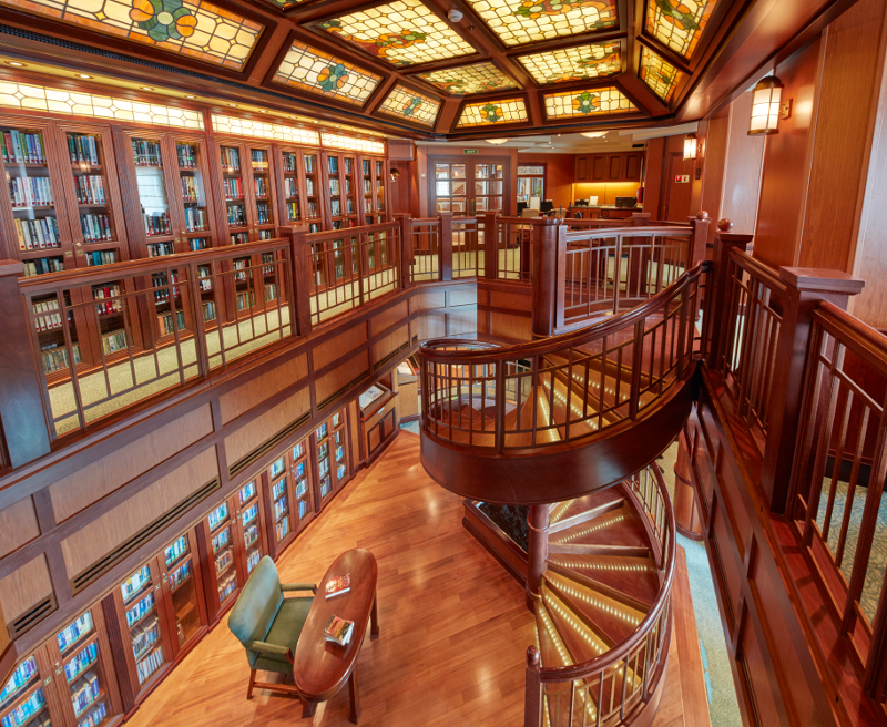 The elegant and well-stocked library on Cunard's Queen Victoria