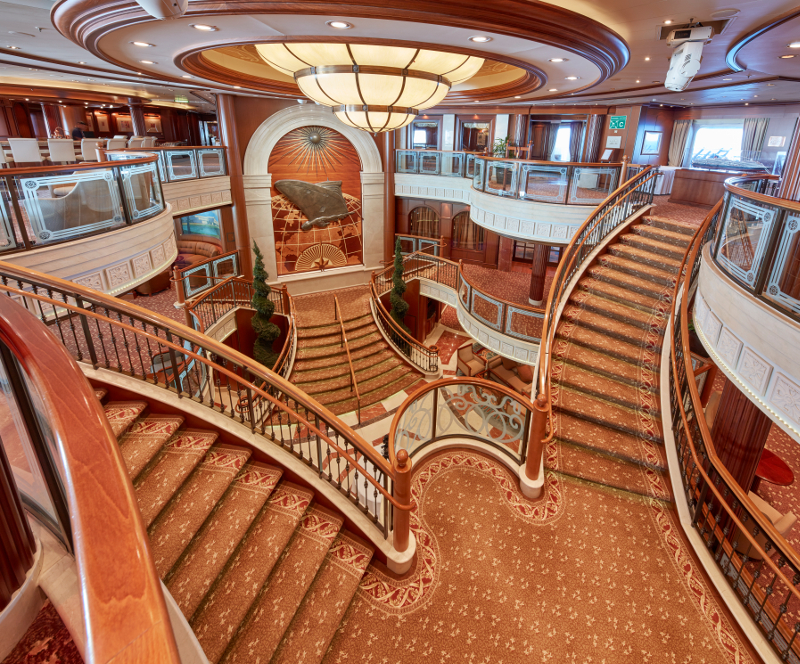 The stairs leading to the Britannia, the onboard formal  dining room on the Queen Victoria