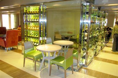 A picture of The Glass House, a relaxed restaurant that offers wines selected by Olly Smith, on board of Azura.