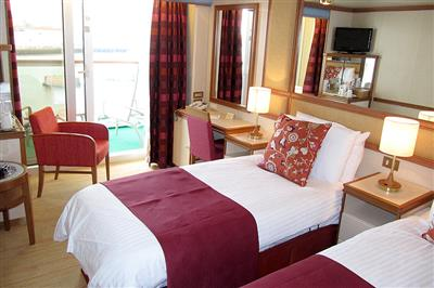 A twin cabin with a great balcony on board of Azura.
