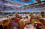 Tables set for dinner onboard Carnival Glory.