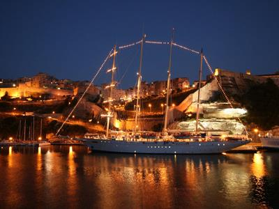 Exterior at night: lights on to party on the  Royal Clipper