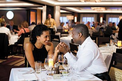 A couple enjoying dinner on the Norwegian Epic