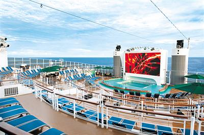 The giant screen in the pool area on Norwegian Epic