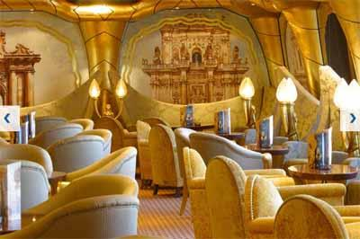 The golden seating area of Grand Bar Salento, the lounge on Costa Magica's deck 5