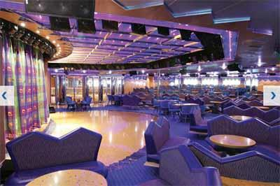 The electric blue seatings  and dance floor of Salone Capri, the deck 4 lounge on Costa Magica