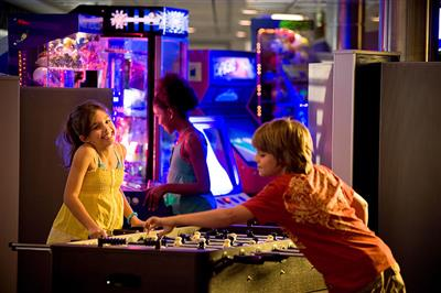 Kids playing foosball at the Fun Factory, Celebrity Eclipse's area dedicated to the teens.
