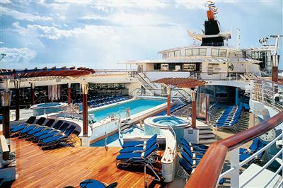 Celebrity  Summit's outdoor swimming pool seen from an higher deck.