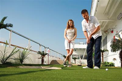 A couple practicing their short game on Luminosa's Putting Green