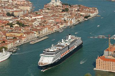 The MS  Westerdam sailing into a canal