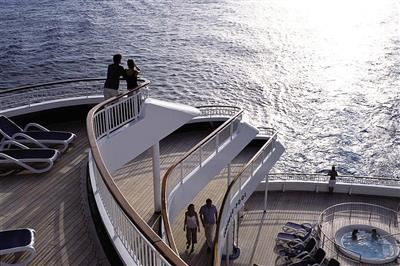 Passengers are enjoying the view from the Aurora's sun terrace.
