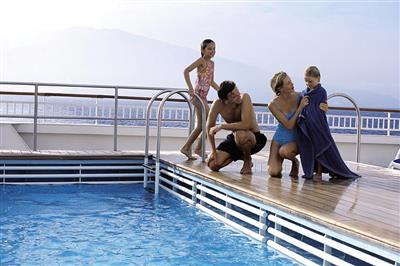 A family enjoying the pool on-board Aurora.