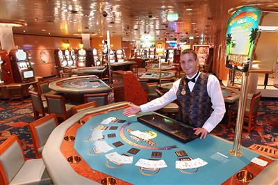 A croupier gets ready for the evenings in the Las Vegas Style Casino onboard Caribbean Princess