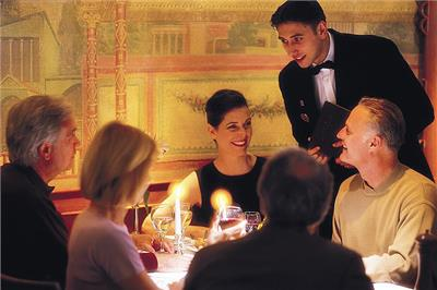 A waiter advising a table