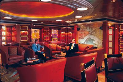 Guests relax in the Viking Crown Lounge, the comfortable lounge bar on Adventure of the Cruise.