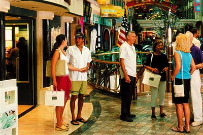Passengers chatting in the shopping mall inside Adventure of the Seas.