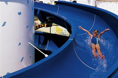A kid enjoying the waterslides on the Adventure of the Seas.