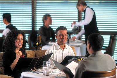 Customers checking the menu, ready for another exciting dining experience on the Brilliance of the Seas.
