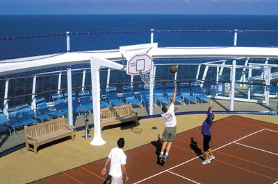 Passengers enjoing the Basketball Court on Royal's Brilliance of the Seas.