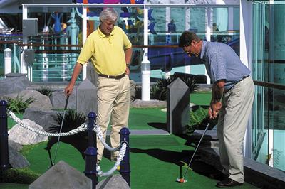 Passengers enjoying mini golf on Royal Caribbean's Brilliance of the Seas.