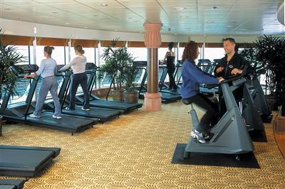 Passengers working out in the gym onboard Brilliance of the Seas.