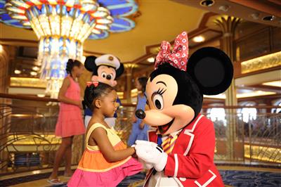 Performers wearing Minny Mouse costumes entertain the kids