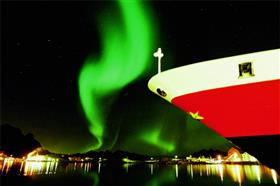 Details of the MS Lofoten's bow heading toward the aurora borealis