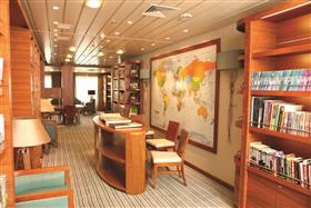 The library on Saga Pearl's Promenade deck