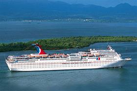 An aerial view of Carnival Fascination sailing against a beautiful landscape