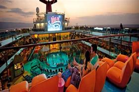 Passengers enjoying Dive-In Movies, the big screen onboard Carnival Fascination.