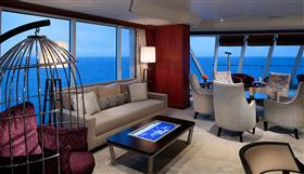 The Living Room, with clusters of large comfortable chairs and sofas on-board the Azamara Quest.
