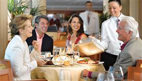 A group of cruisers enjoys dinner on Nautica