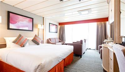 The junior suite cabin with balcony on Marella Discovery by Marella