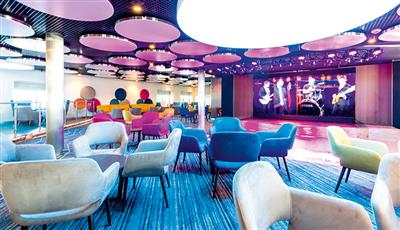 The sitting area of the Live Room, main show lounge on Marella Discovery