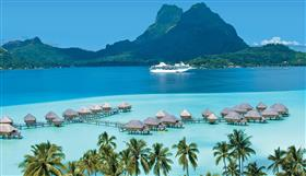 MS Paul Gauguin sailing the emerald sea of the Tahiti archipelago