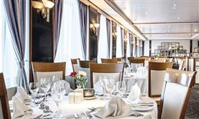 The Seven Seas Restaurant, on Thomson Majesty's deck 5