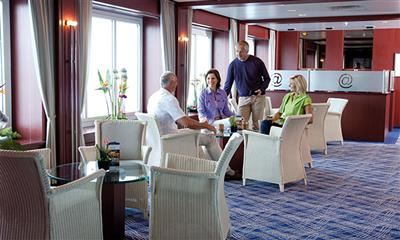 Four passengers are chatting in the cafe on-board Astor.