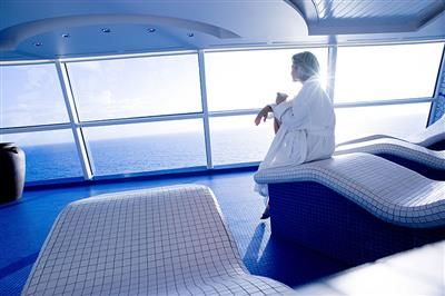 Passenger enjoying the sea's view from the Spa on Celebrity Eclipse.