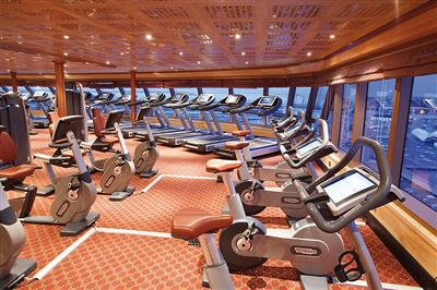 The gym with ocean views on Costa Luminosa